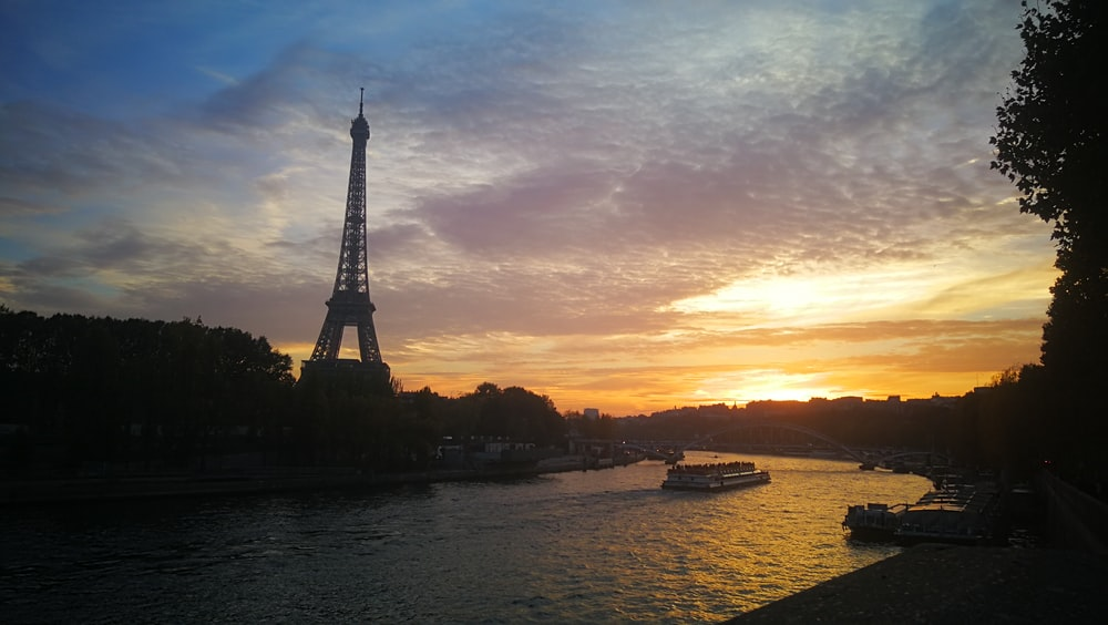 silhouette of eiffel tower during sunset