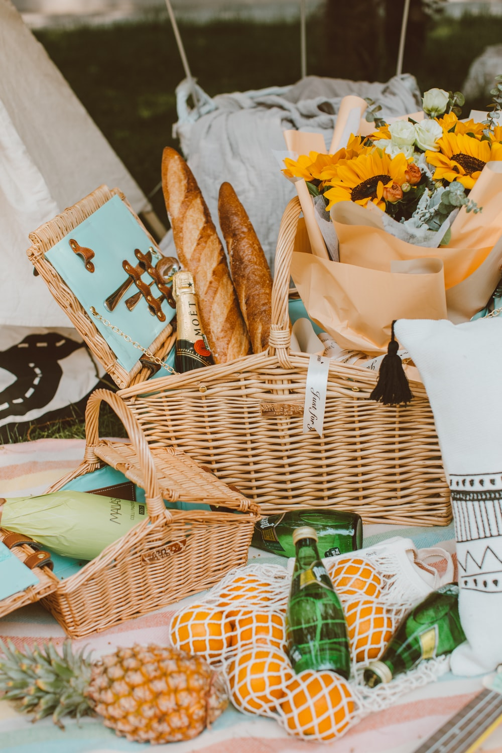 brown wicker basket with white and yellow flowers