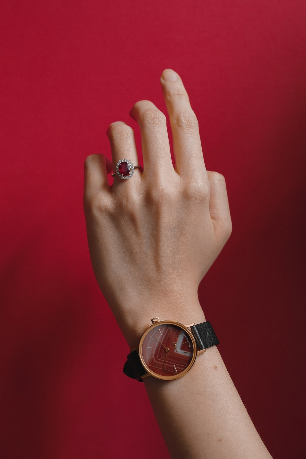 person wearing gold and black analog watch