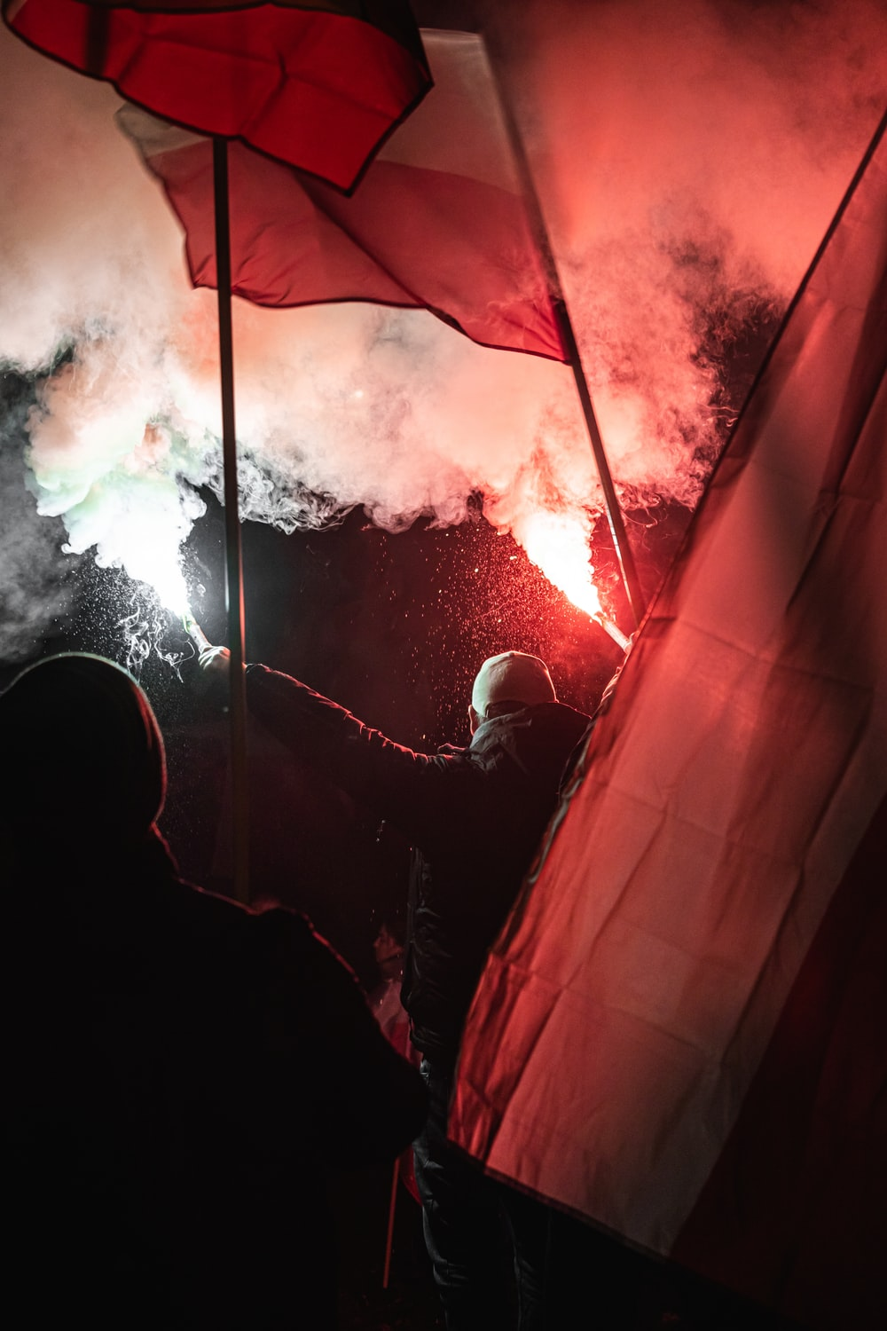 red and white tent with fire