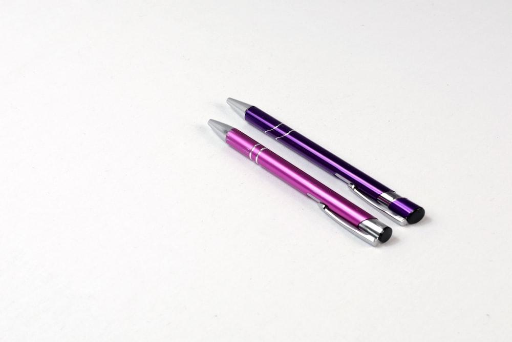 purple and white click pen