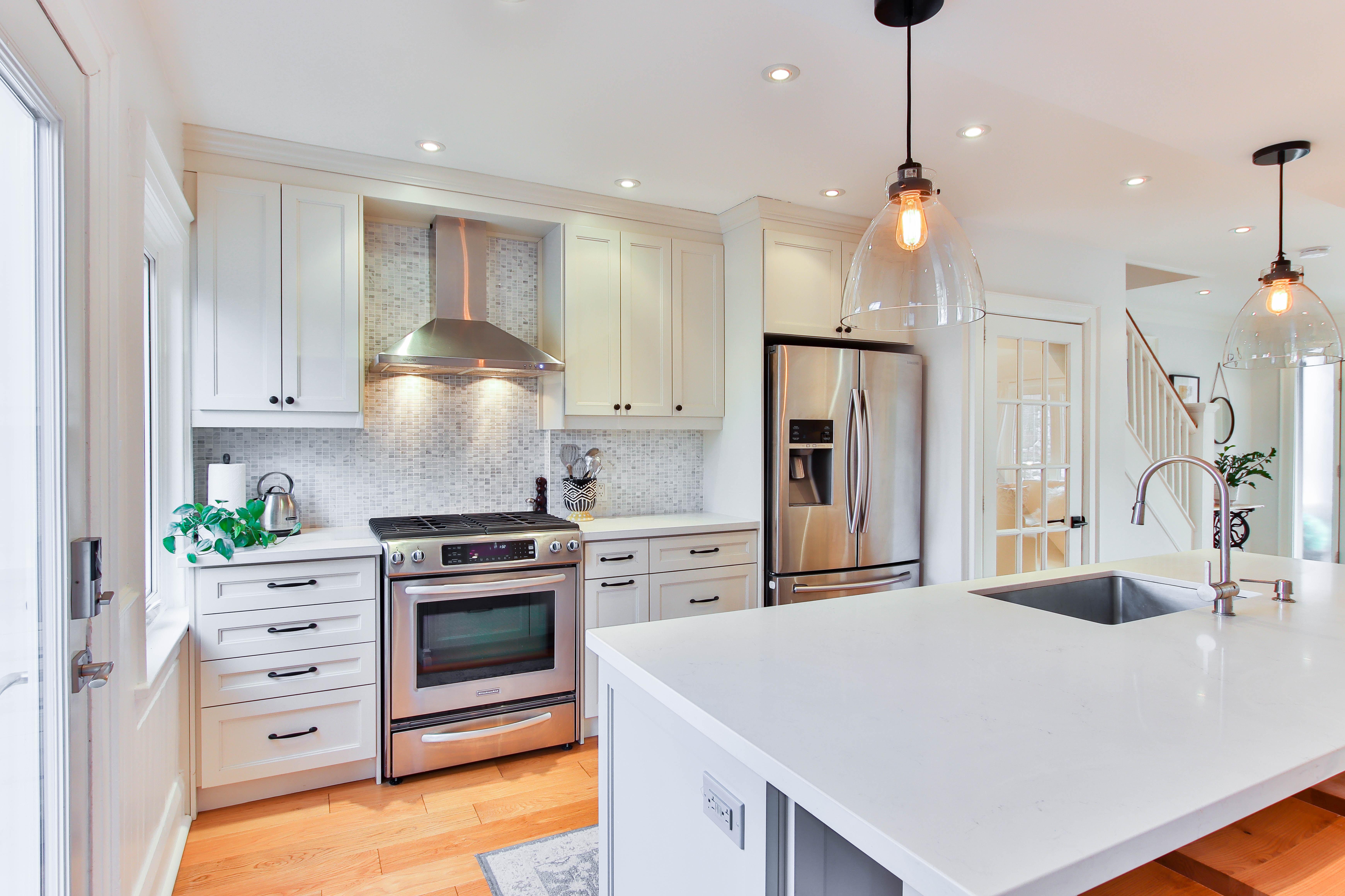 white wooden kitchen cabinet and white kitchen counter