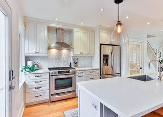 white wooden kitchen cabinet and white kitchen counter