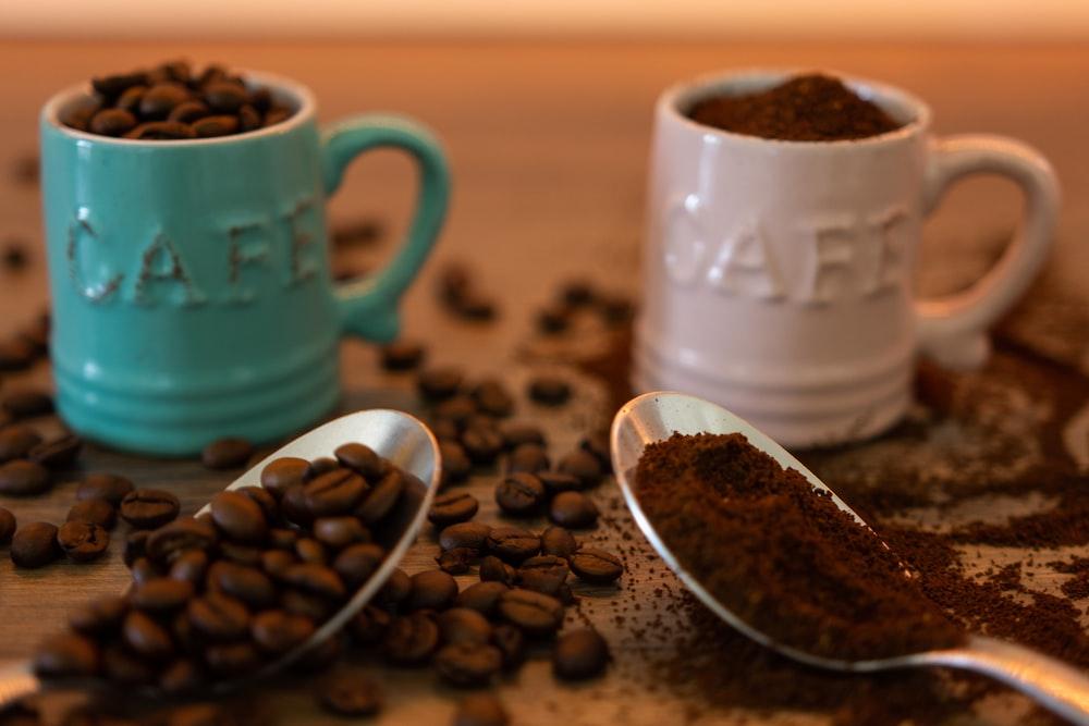 green ceramic mug with coffee beans