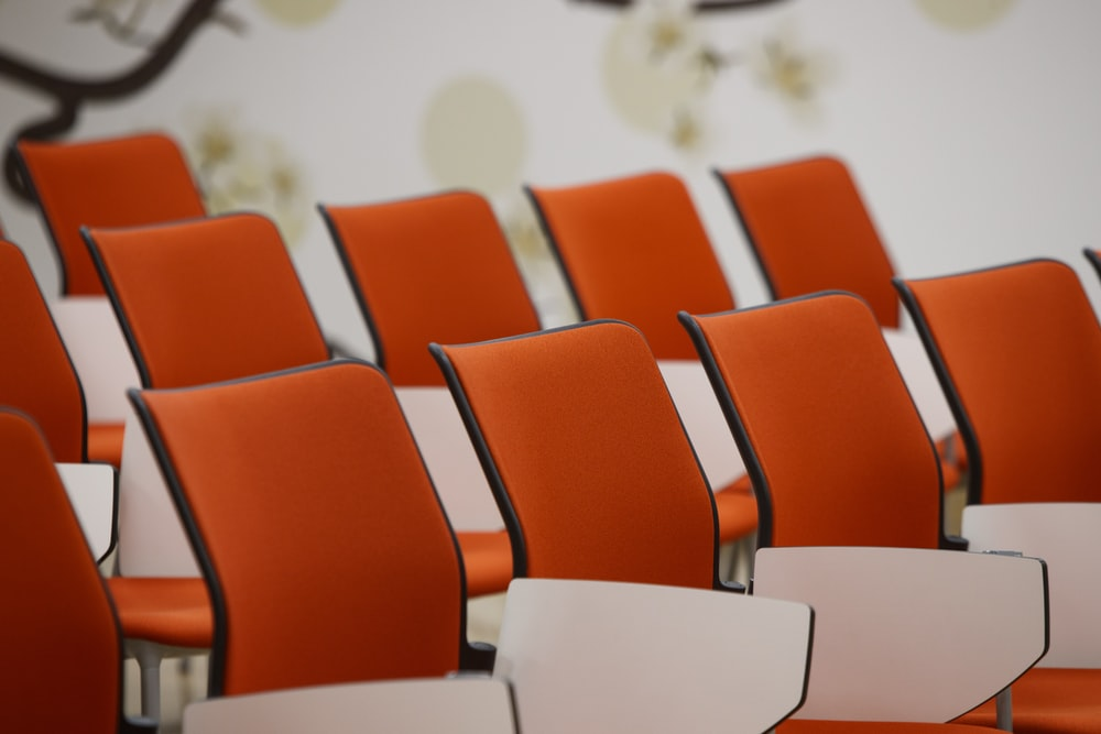 orange chairs in white room