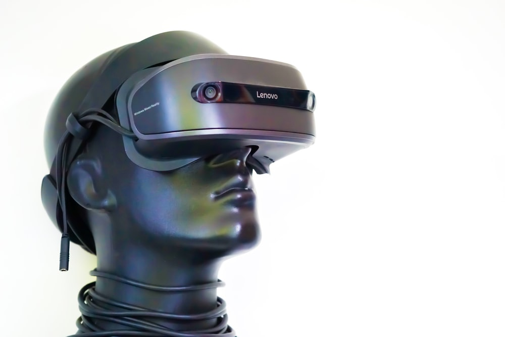 black and gray robot with goggles