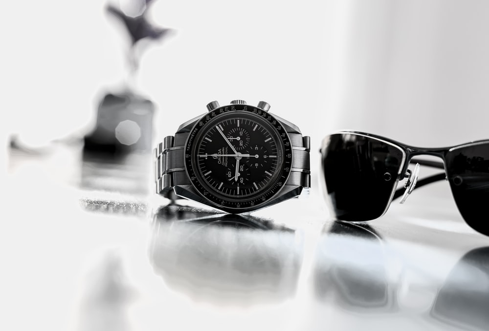 black and silver round analog watch