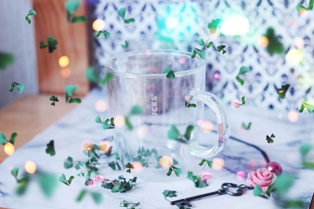 clear glass mug on white table