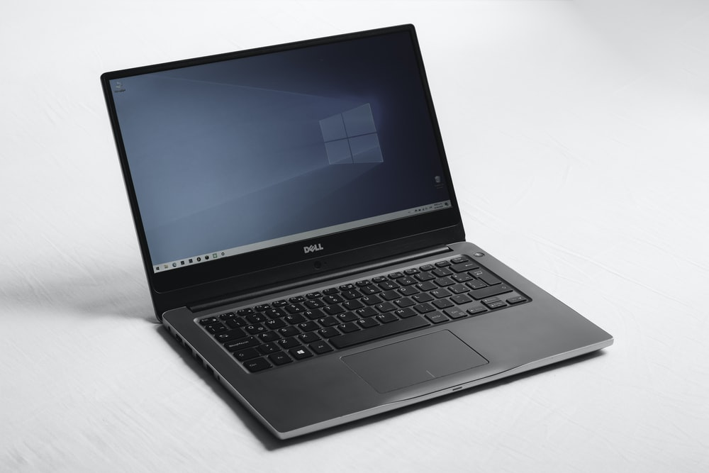 black and silver asus laptop computer