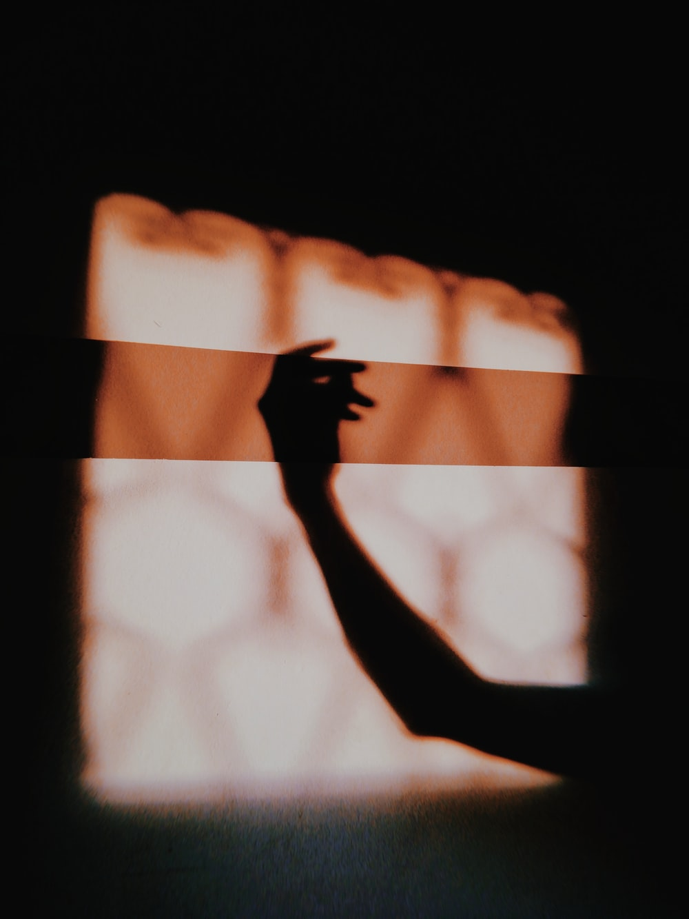 silhouette of person raising right hand