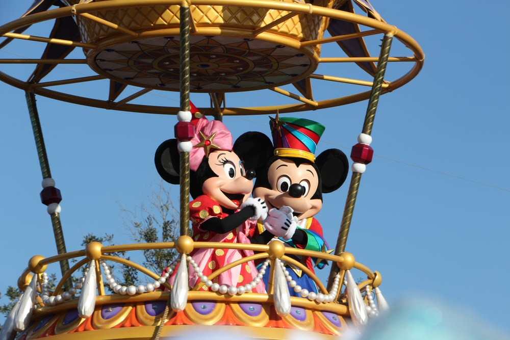 mickey mouse riding on swing ride
