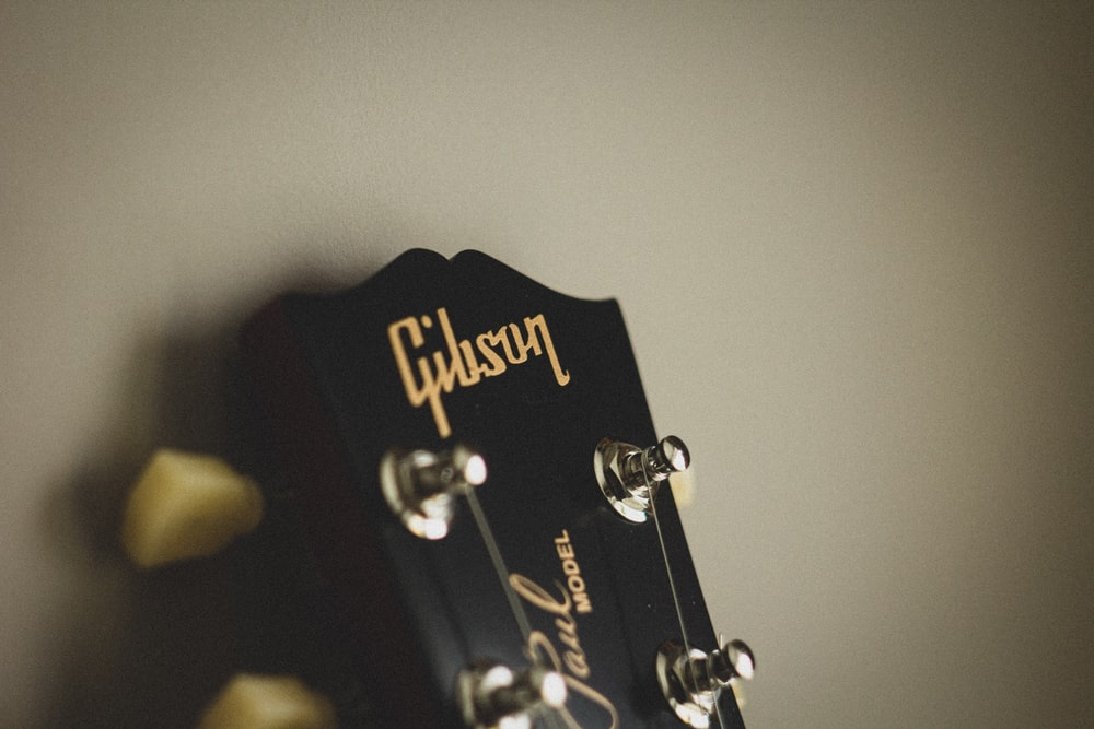 black and gold guitar pick