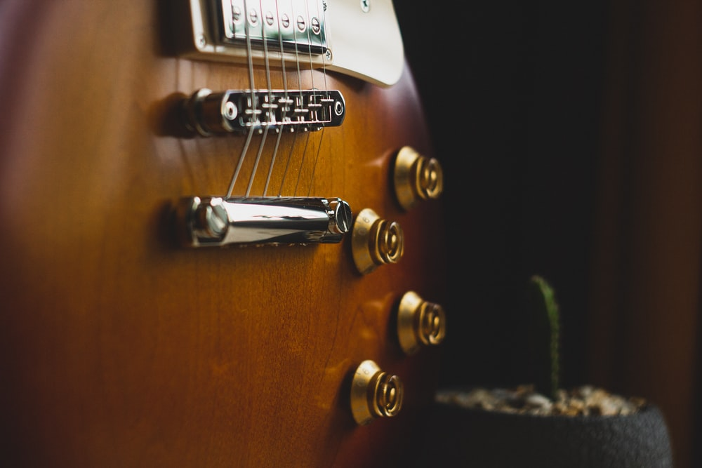 brown and white guitar head stock