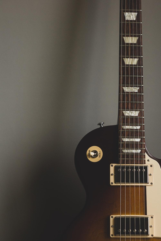 black electric guitar on black wall