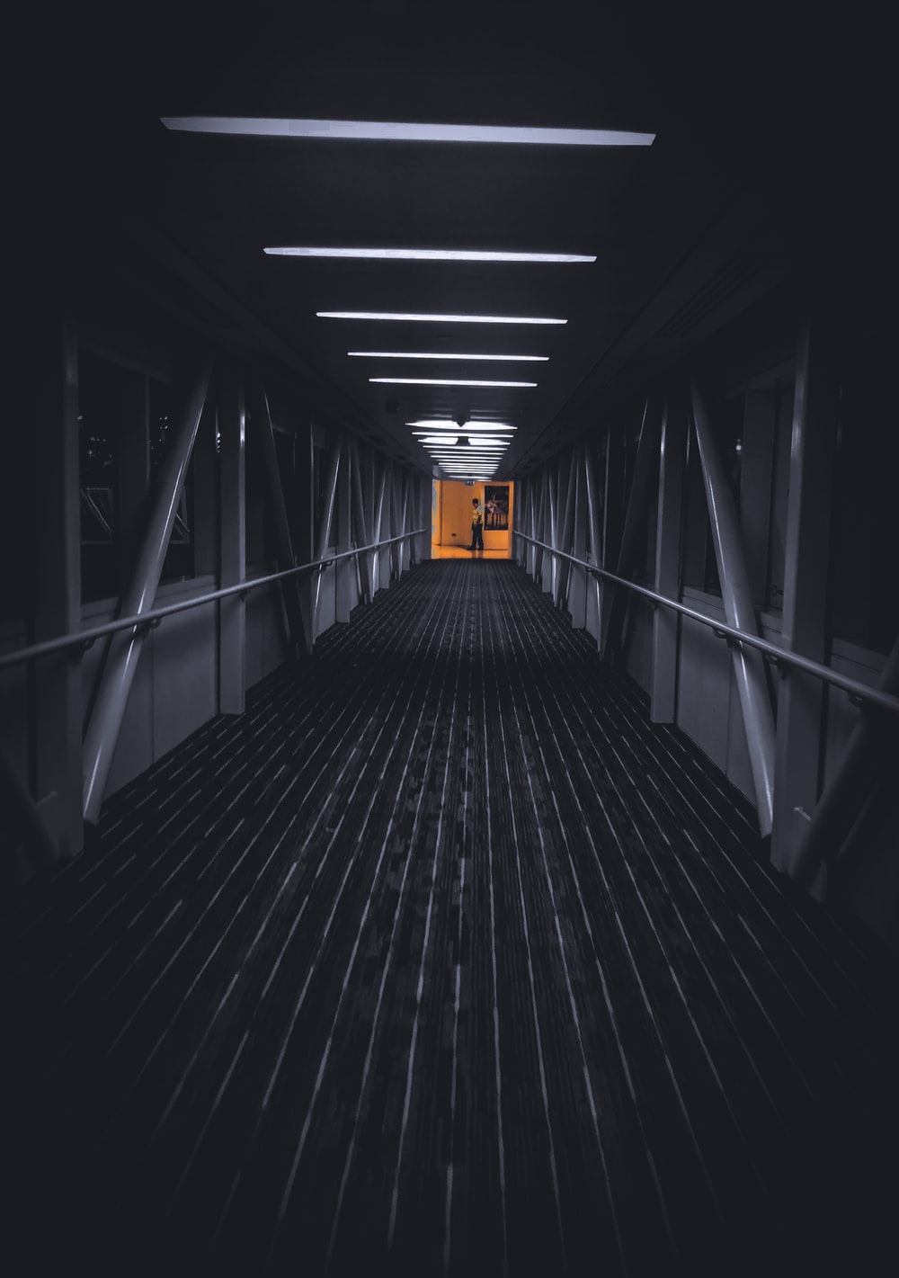 black wooden tunnel with white ceiling light