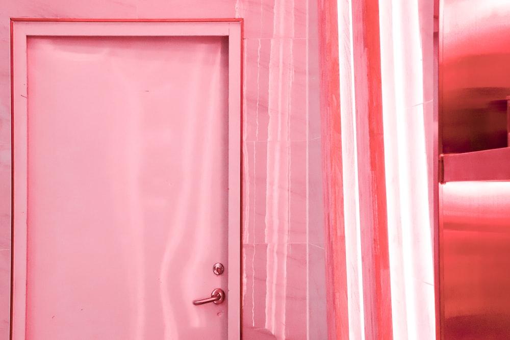 pink ceramic bathtub with white shower head