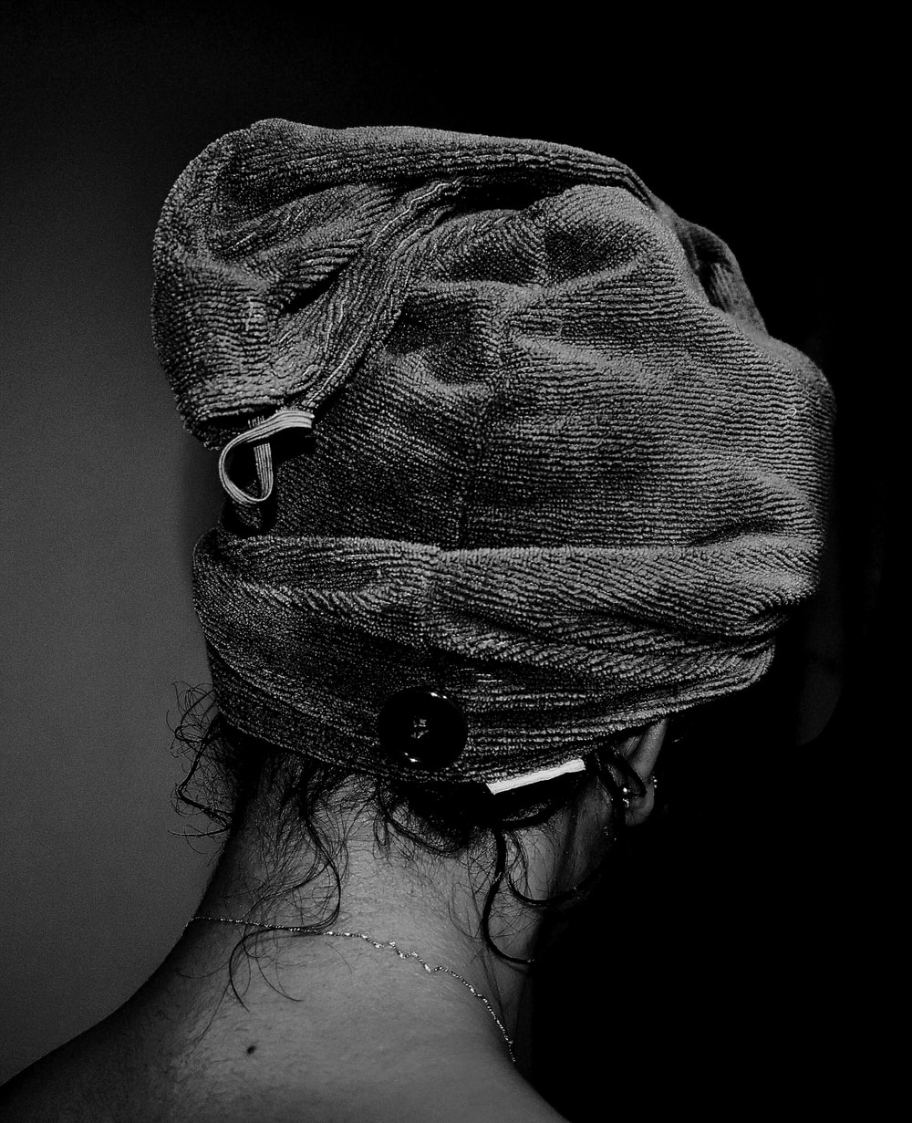 grayscale photo of woman with black and white hair tie