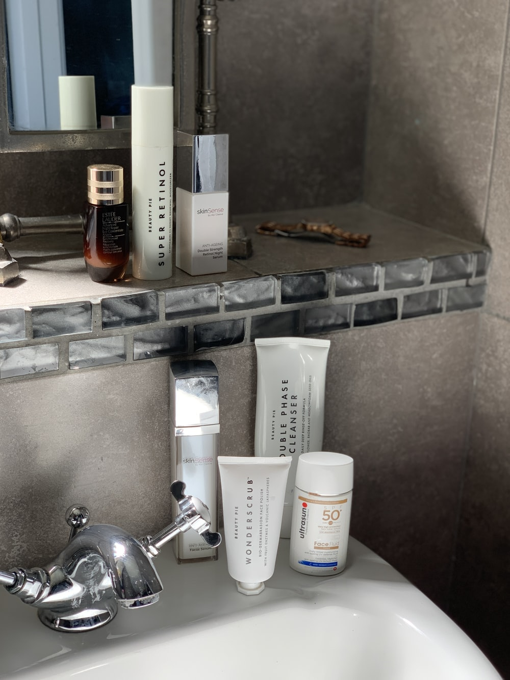 white plastic bottle on stainless steel sink