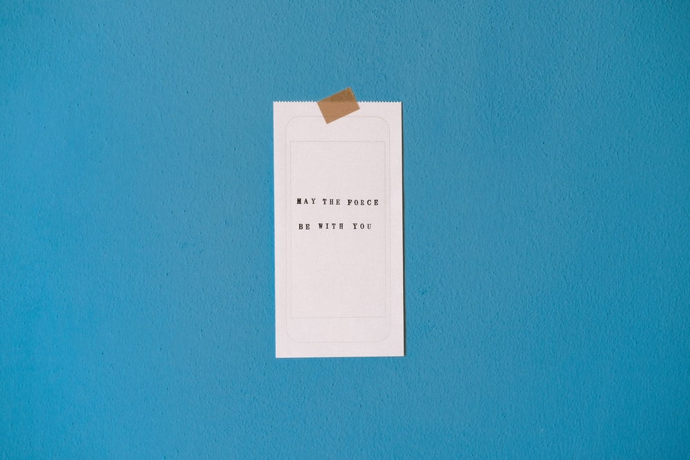 white printer paper on teal wall