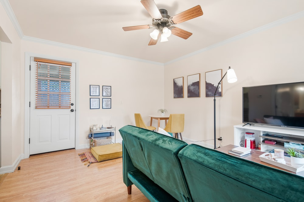 white and brown 4 bladed ceiling fan with light fixture