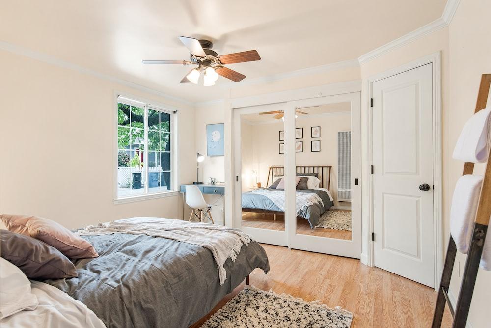 white wooden door near white bed