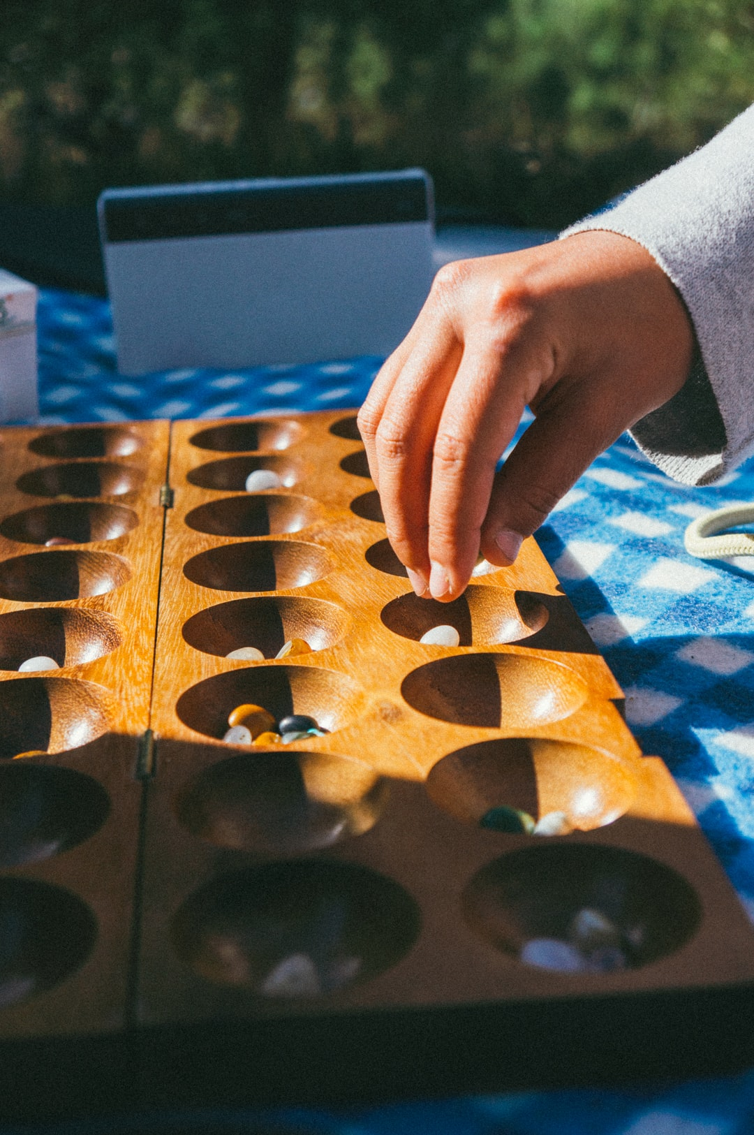 Person playing mancala the game