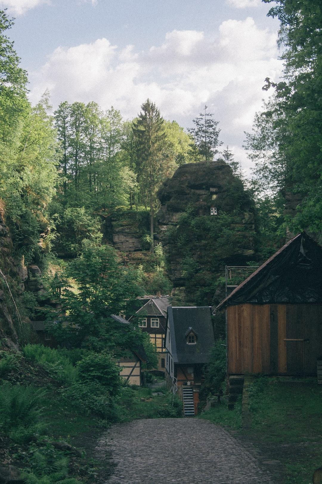 Little hidden houses in a green landscape
