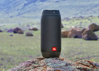 black and red speaker on rock