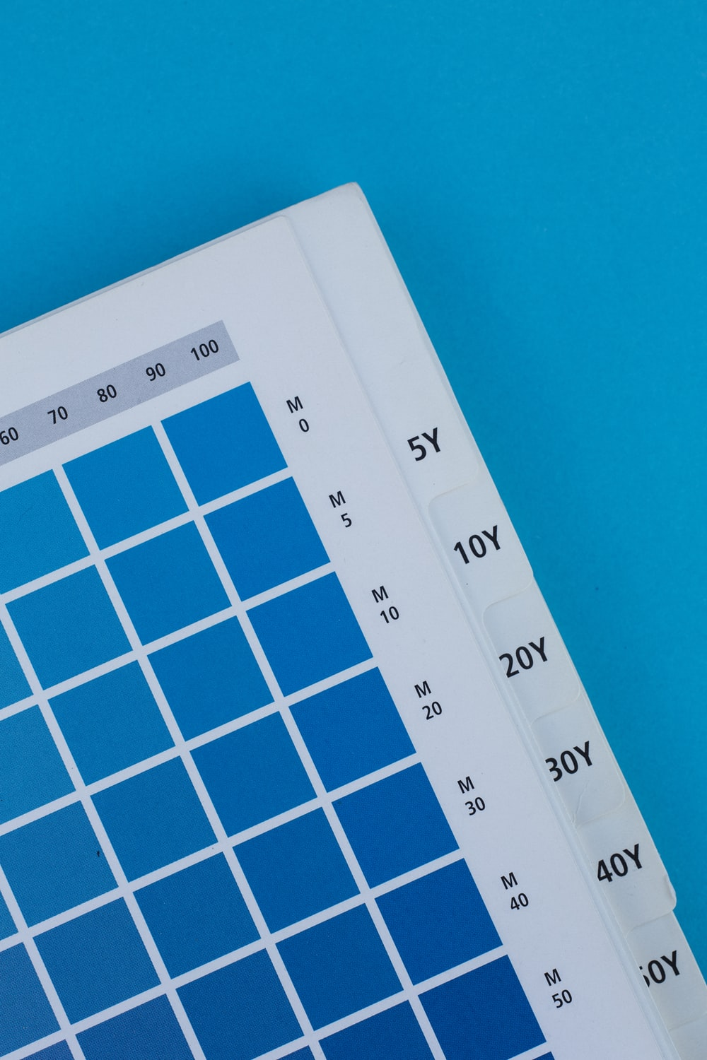 white and blue calendar on blue wall