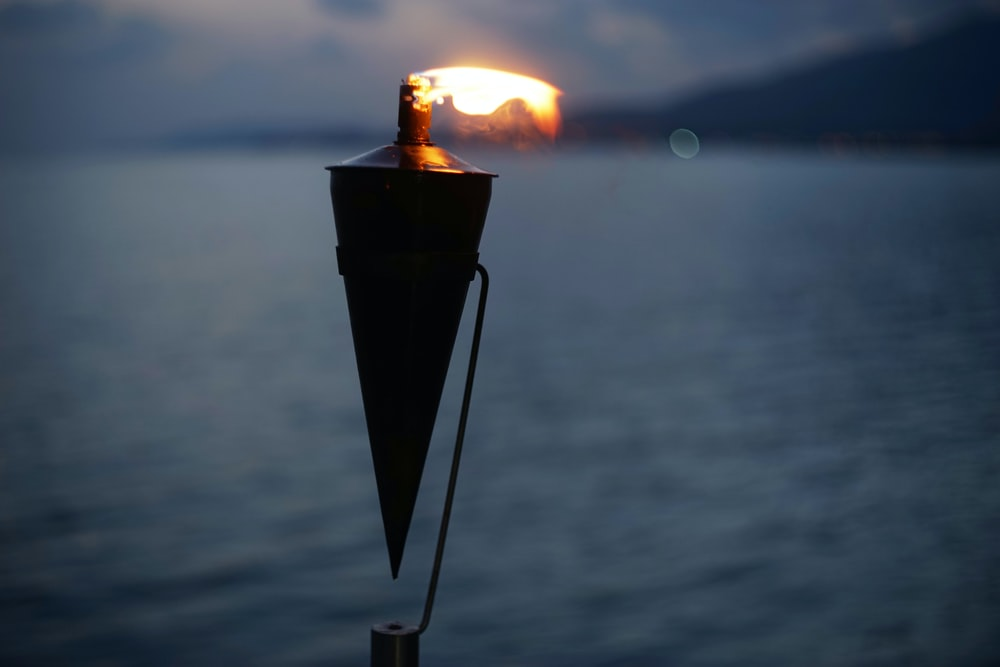 black and brown torch with fire