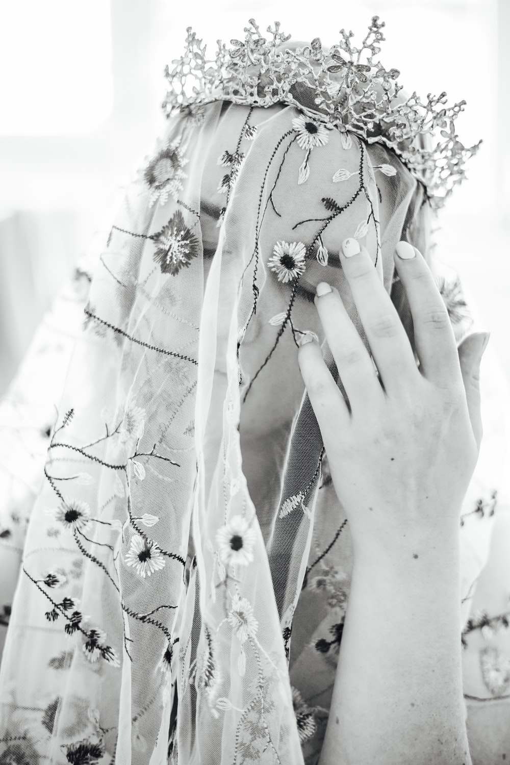 woman in white floral dress with white flower headdress