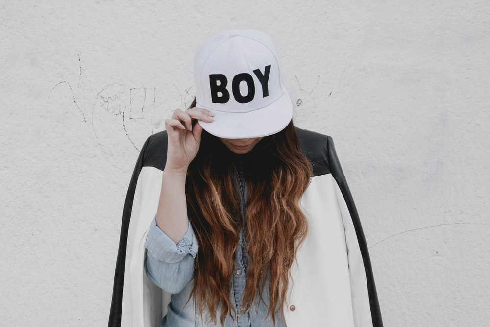 woman in white nike fitted cap and gray long sleeve shirt