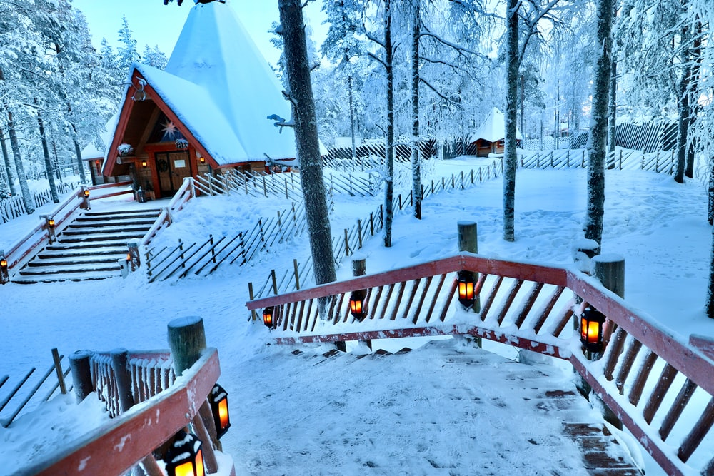 brown wooden bench on snow covered ground