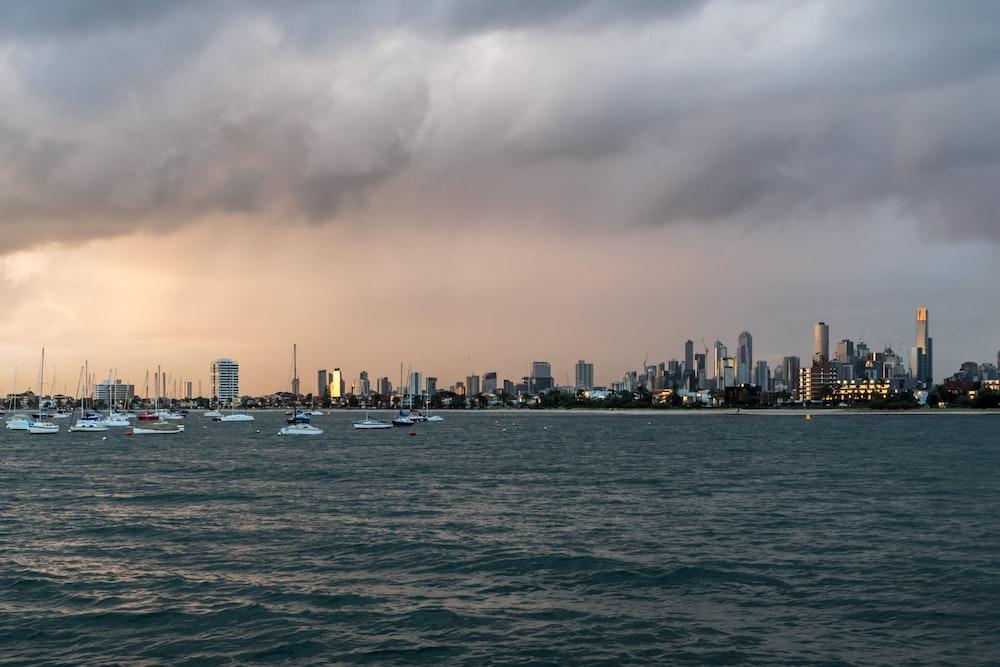 city skyline under gray clouds during daytime