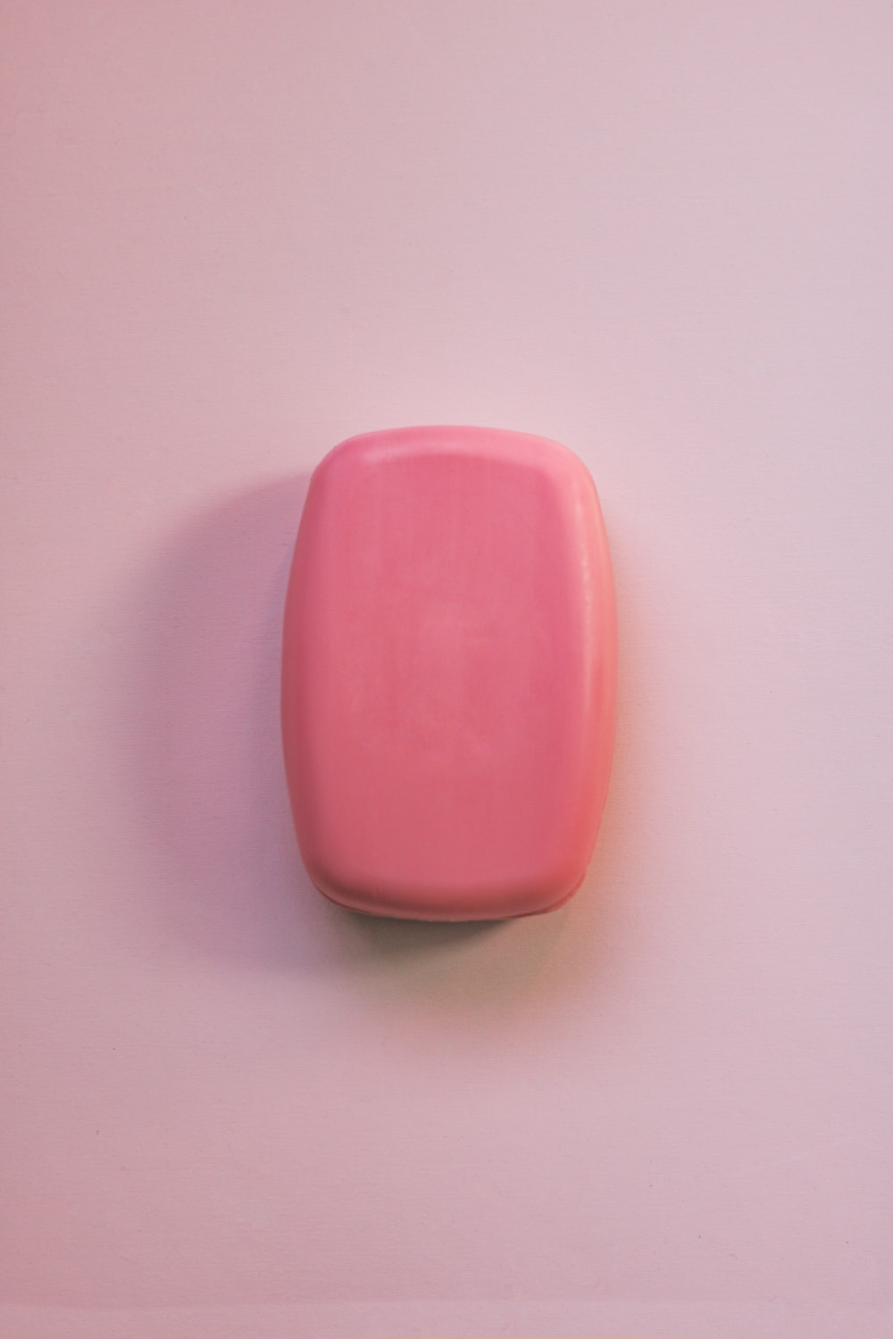pink plastic case on white surface