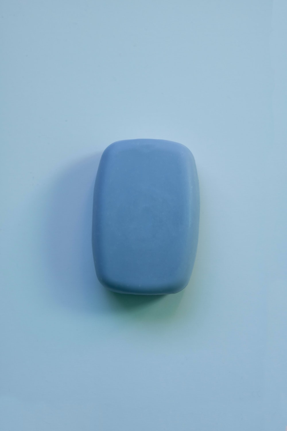 blue plastic container on white table