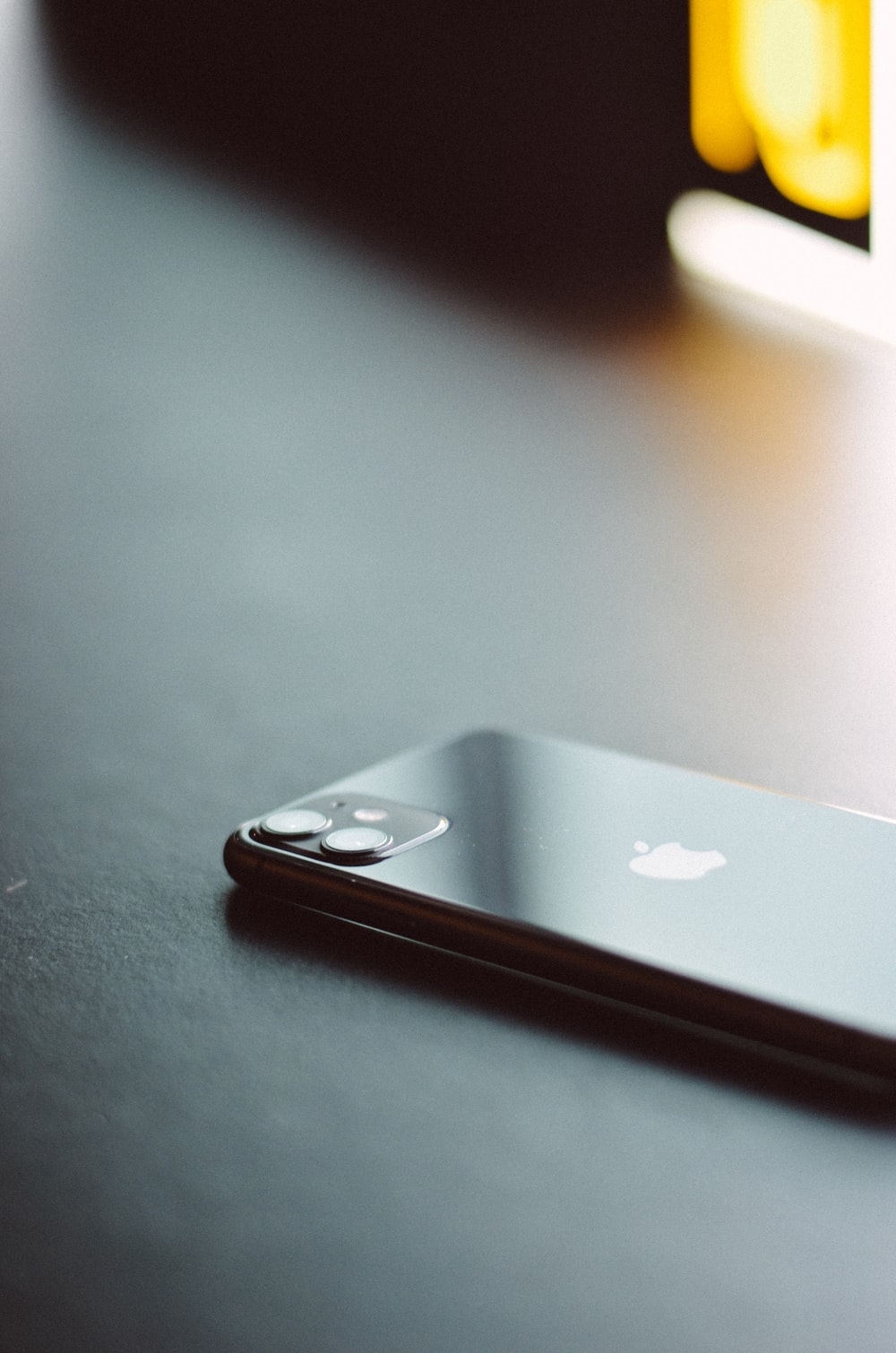 silver iphone 6 on black table