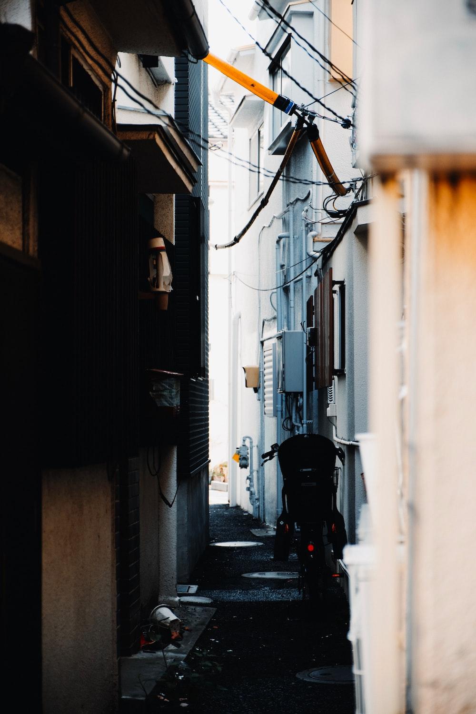 man in black jacket walking on street during daytime