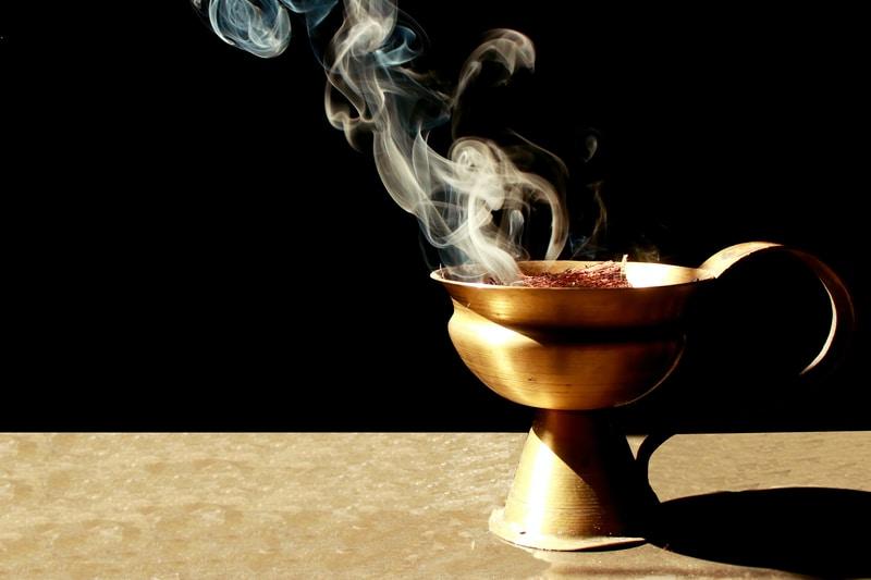 brown ceramic cup with smoke