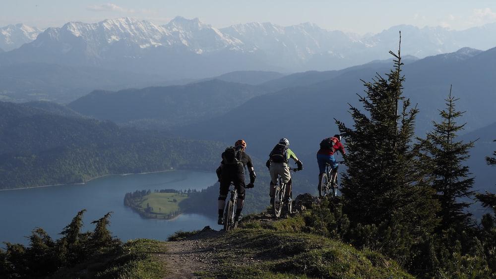 people hiking on mountain during daytime