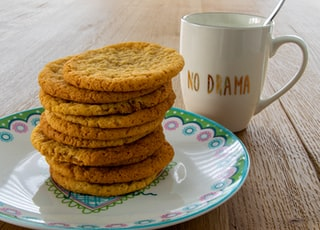 brown cookies on white and pink ceramic plate