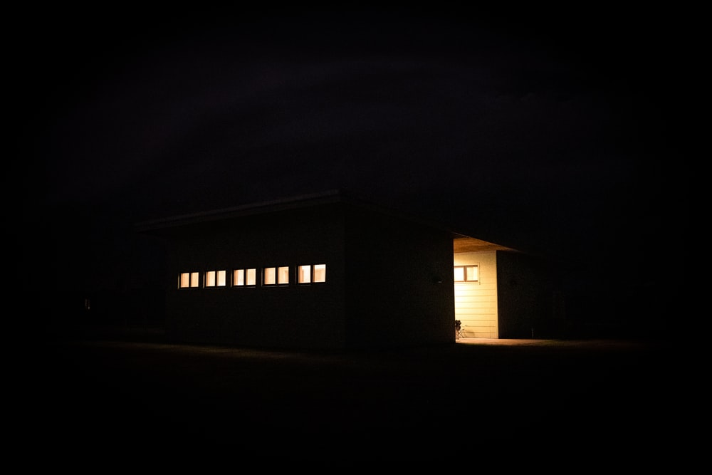 white and brown wooden house during night time