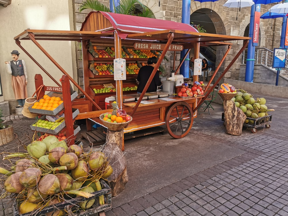 fruits in brown wooden cart