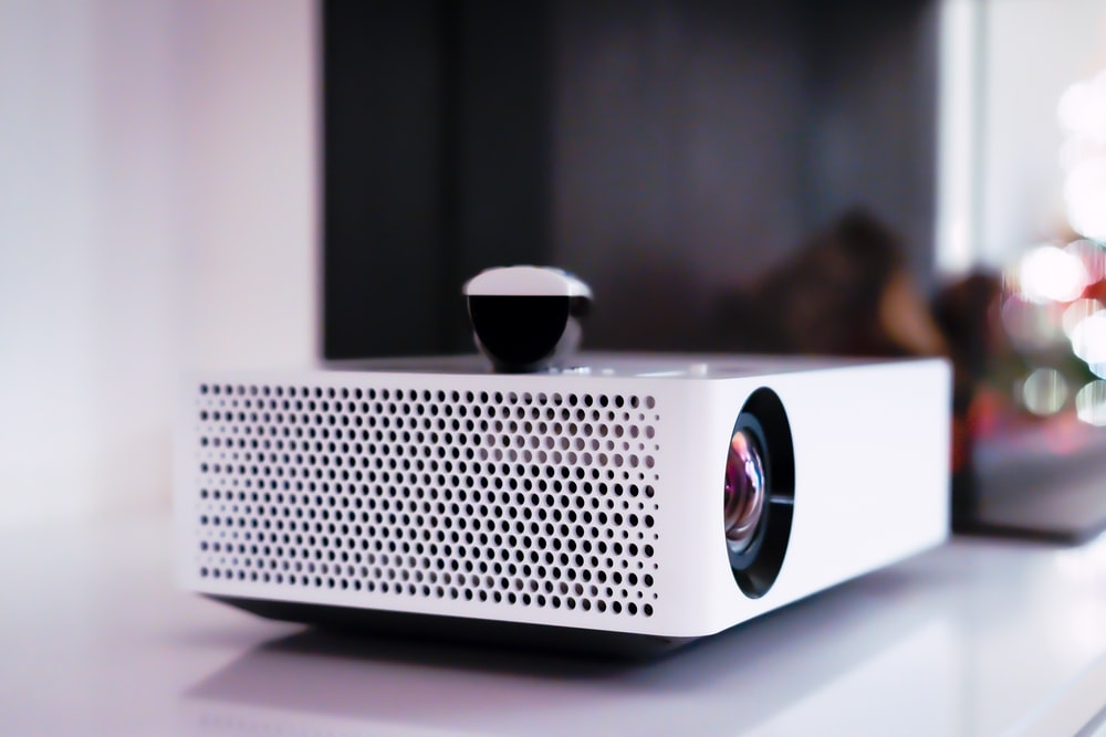 black and white projector on white table