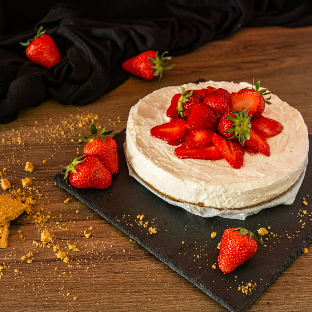 strawberry on white ceramic plate