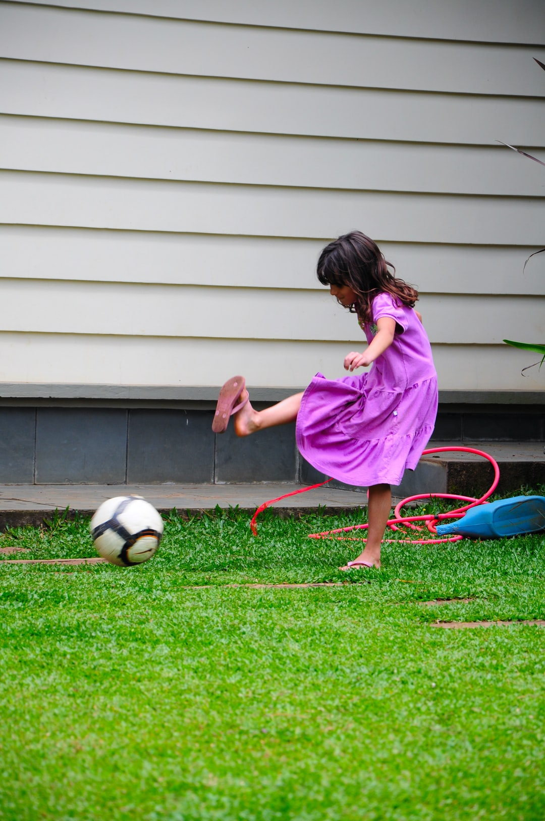 A girl playing at grass