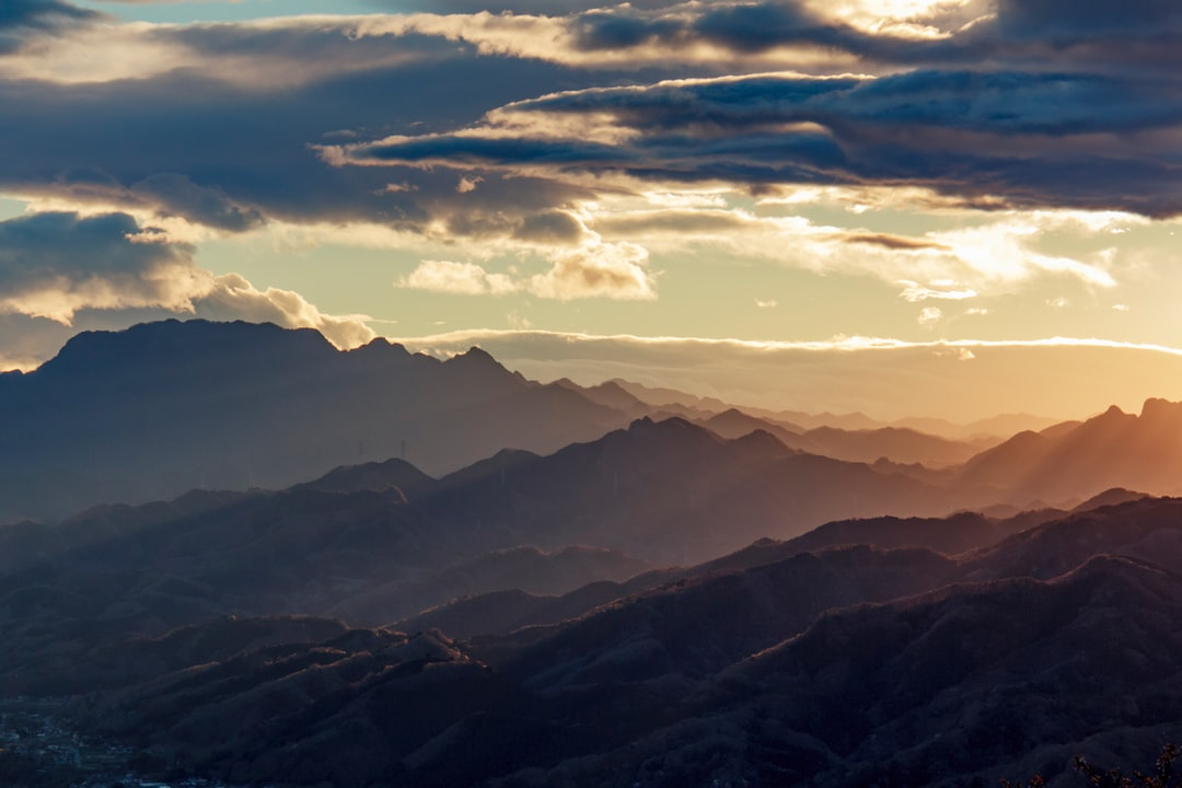 Overlaping mountains with evening light.