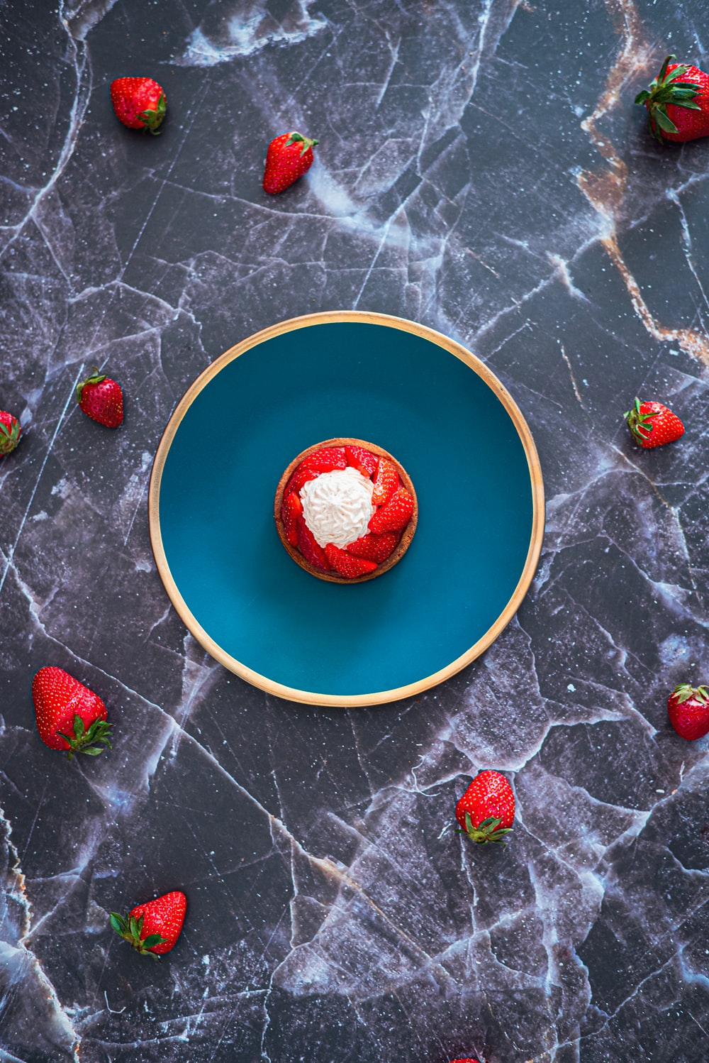 strawberries on yellow and blue ceramic plate