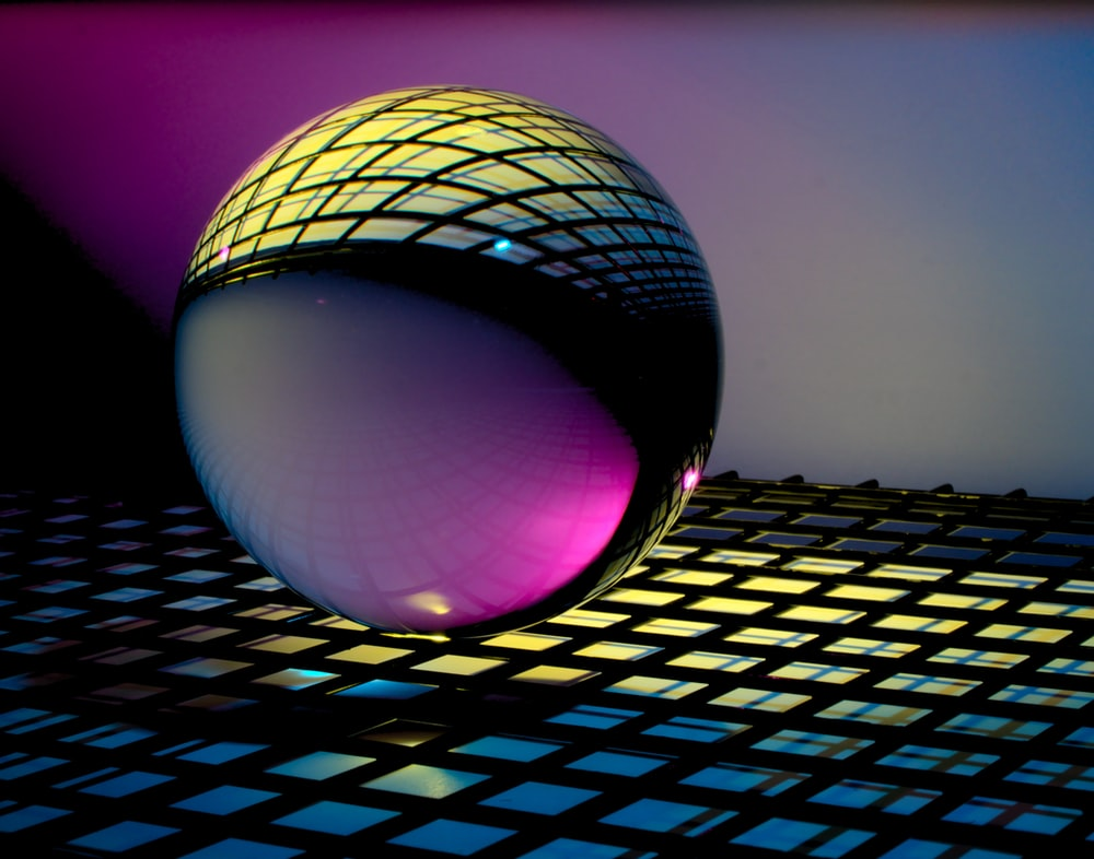 blue and black ball on blue and white checkered textile