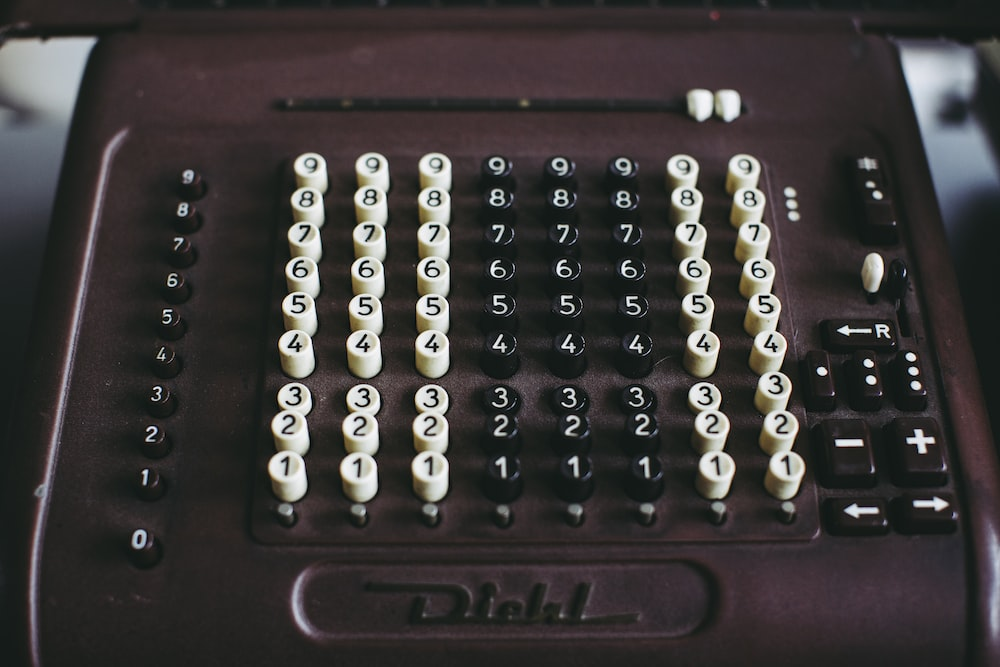 silver and black beads on brown wooden box